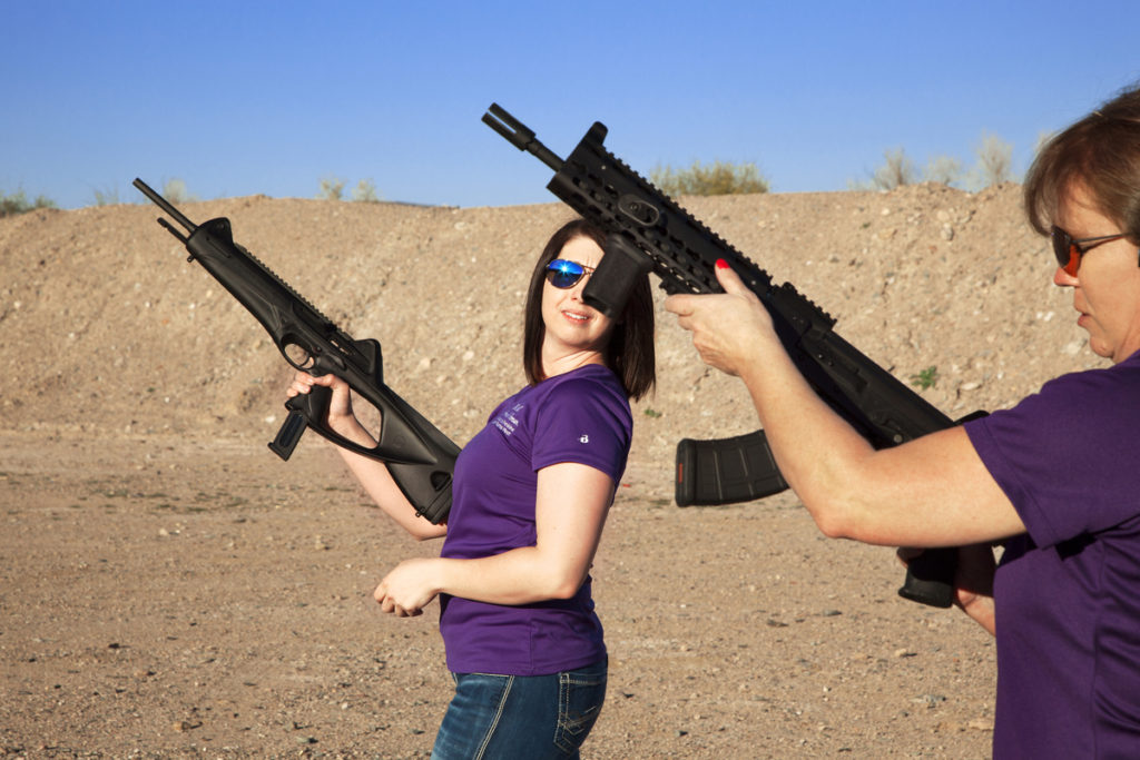 Carrie Lightfoot (R) holds a AK 47 in her hands while her colleague Nicole Goldberger (L) a Beretta C4 Storm. Peoria. Arizona, USA - 2016