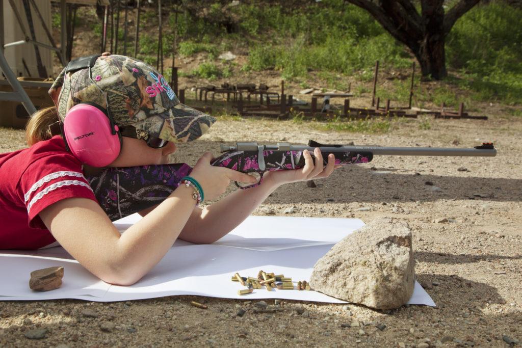 Dakota Stonecipher, 8 years old, is training her shooting skills with her Henry Mini Bolt .22 - Single Shot Bolt Action Rifle, Arizona, USA - 2016