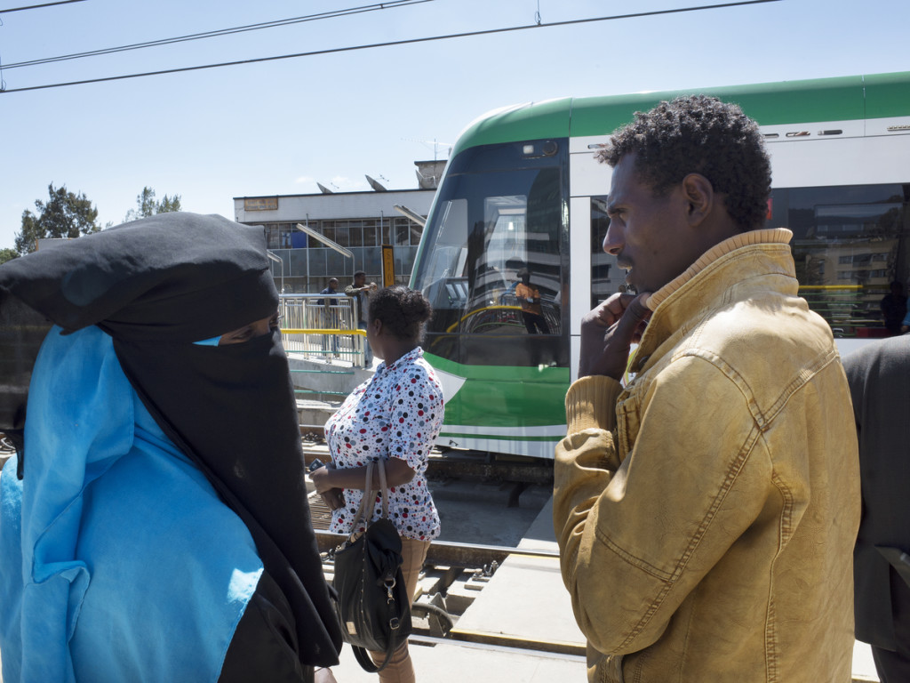 A muslim couple and other passengers wait on tramway station in Addis Ababa, Ethiopia - 2015